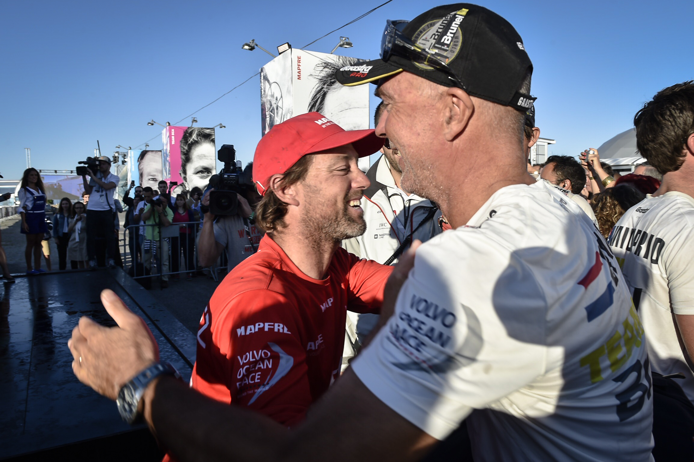. MAPFRE arrives to Lisbon in second position after Leg 7 from Newport. MAPFRE Skipper Iker Martinez and Team Brunel Skipper Bouwe Bekking congratulate each other on stage. (Photo by Ricardo Pinto / Volvo Ocean Race )