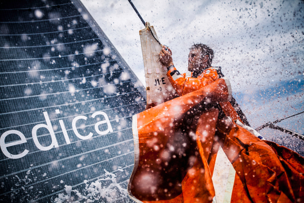 Leg 6 to Newport onboard Team Alvimedica. Day 15. Nick Dana finishes hanging on the J1 jib before peeling to the smaller sail in a building breeze. Through the cold front, it's back upwind in 15-20 knots north towards Newport and colder water, 750 miles away. (Amory Ross / Team Alvimedica / Volvo Ocean Race )