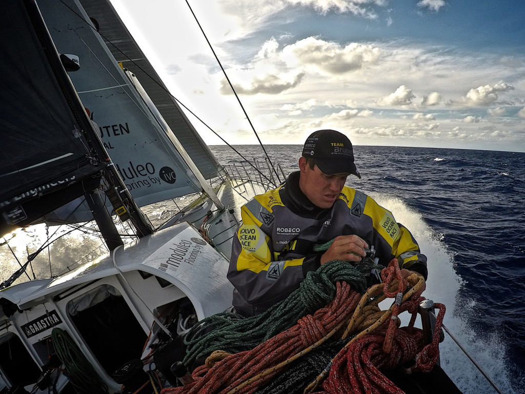 Leg 6 to Newport onboard Team Brunel. Day 15. Rokas Milevicius stacks the sheets to the high side of the boat when the wind suddenly picks up. (Photo by Stefan Coppers / Team Brunel / Volvo Ocean Race )