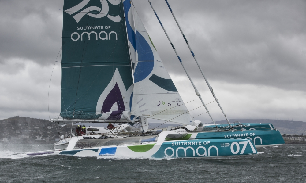 The Sultanate of Oman's MOD70 Musandam -Oman Sail trimaran skippered by Sidney Gavignet (FRA). Shown here as the team cross the line and set a new world record for sailing round Ireland in 40h51m57s (unofficial - official to follow) Credit - Lloyd Images