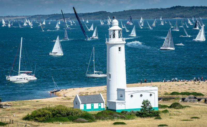 The Rolex Fastnet Race fleet at Hurst Castle Lighthouse. The spectacular fleet fills the Solent between the Isle of Wight and the mainland shores © Rolex/Kurt Arrigo