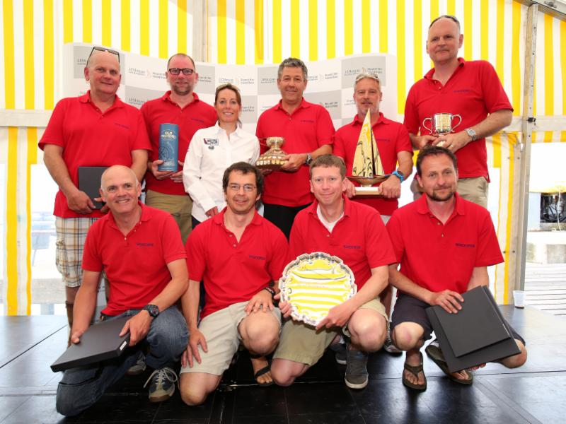 The delighted skipper, Giovanni Belgrano (centre) and his crew of WHOOPER, IRC Division 3B, Winner of IRC Division 3B, the BCYC TROPHY - First BCYC Yacht, the CHAMPAGNE MUMM CHALLENGE CUP - First Overall IRC Group 3 and the GOLD ROMAN BOWL & J.P. Morgan Asset Management SALVER - First Overall IRC  - with Helena Lucas MBE. IMAGE: Patrick Eden.