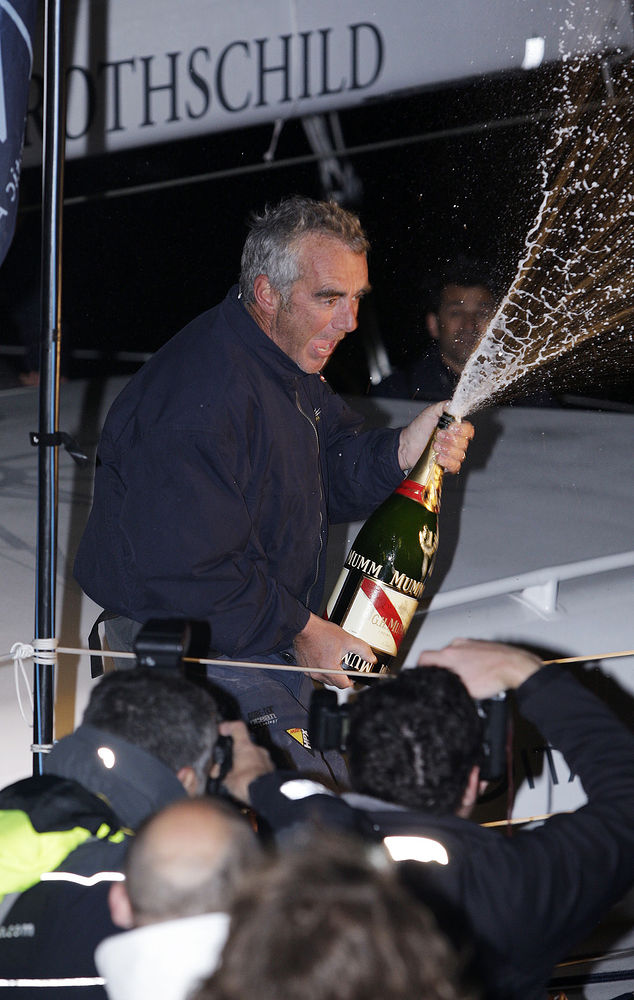 The Transat 2008 - Loick Peyron, IMOCA60 winner  Loick Peyron celebrating with champagne after winning the IMOCA60 class in The Transat 2008 onboard Gitana Eighty  (Photo © OnEdition)