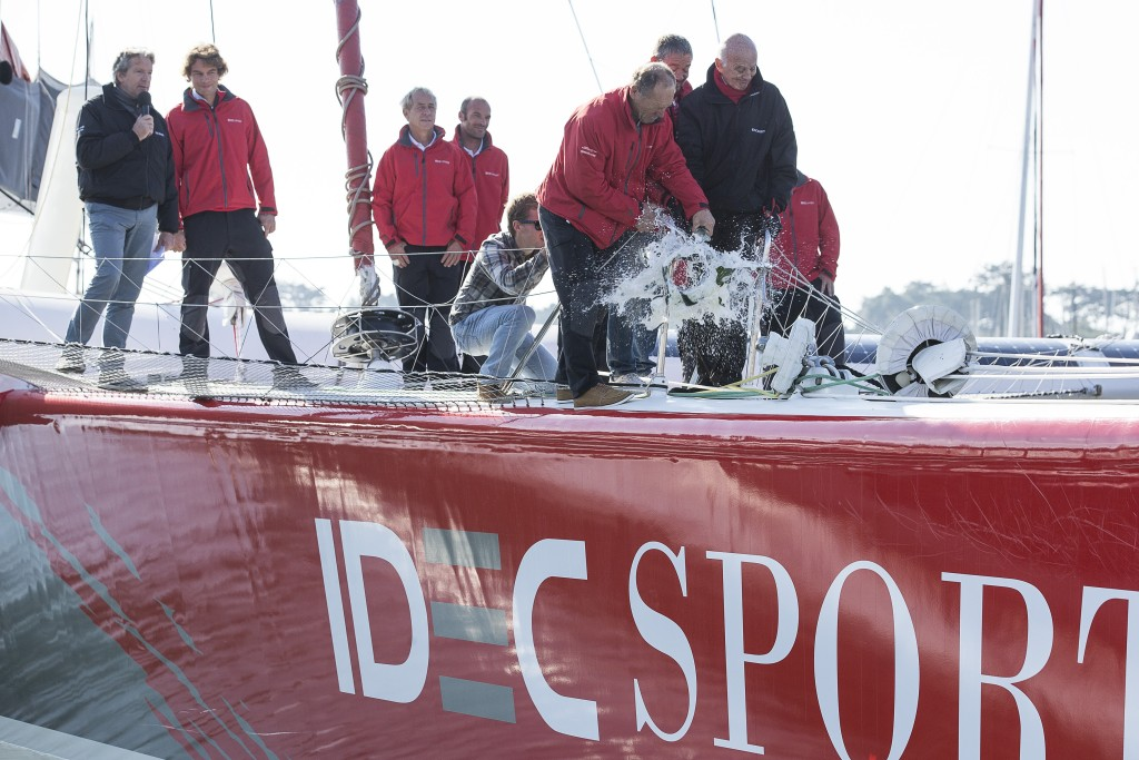 IDEC Sport Maxi Trimaran christening with champagne by skipper Francis Joyon, prior to their circumnavigation record attempt, in La Trinite sur Mer, France, on october 14, 2015 - Photo Jean Marie Liot / DPPI / IDEC - Patrice Lafargue (Pdt IDEC) and Professor Gerard Saillant