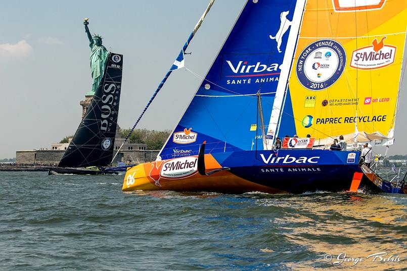 Virbac and Hugo Boss pass the statue of Liberty in the Charity Race NY Vendee (Photo © George Bekris )