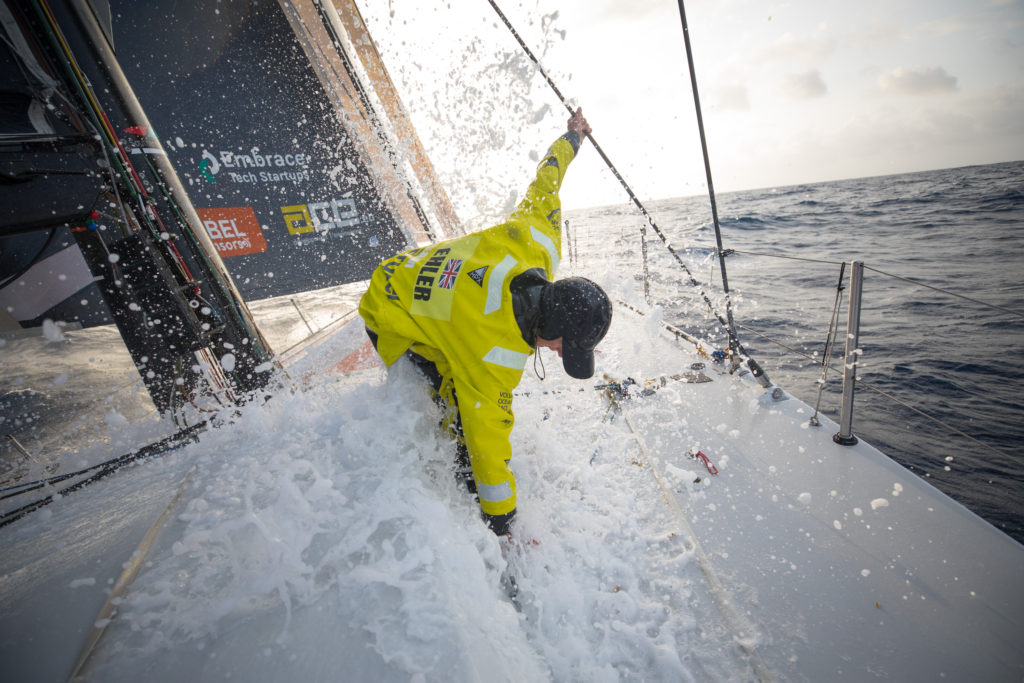 Leg 8 from Itajai to Newport, day 11 on board Brunel. Abby Ehler on the bow cleaning Sargassum weeds. 02 May, 2018.3 Sam Greenfield/Volvo Ocean Race