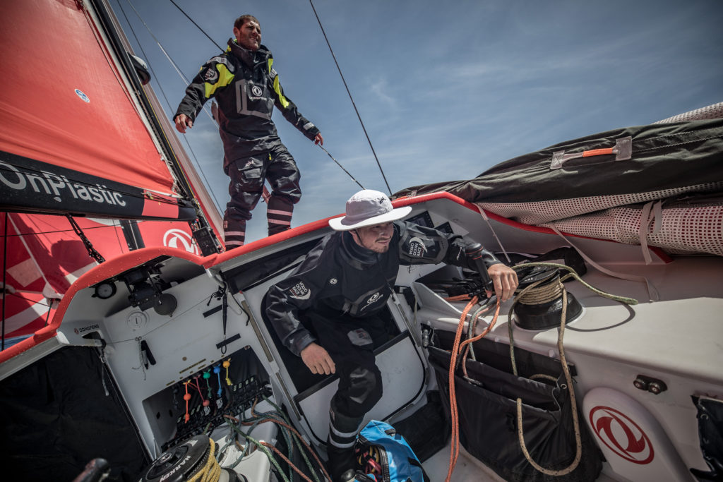 Leg 8 from Itajai to Newport, day 15 on board Dongfeng. 06 May, 2018. Charles Caudrelier stacking while Jackson gets out of the hatch, ready to help. (Photo © Jeremie Lecaudey/Volvo Ocean Race)